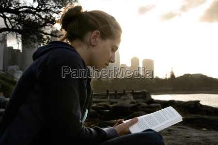 reading woman sitting with book in