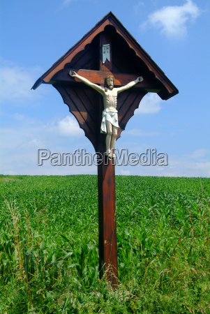 wooden cross in field