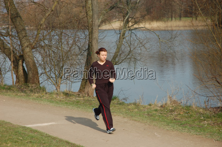 young, woman, jogging, in, city, park - 582317
