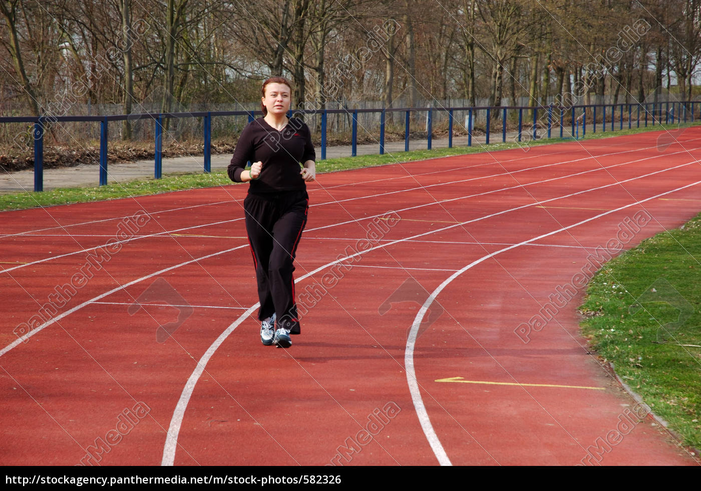young, woman, jogging, in, the, stadium - 582326