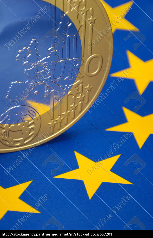 euro, coin, on, the, european, flag - 657201