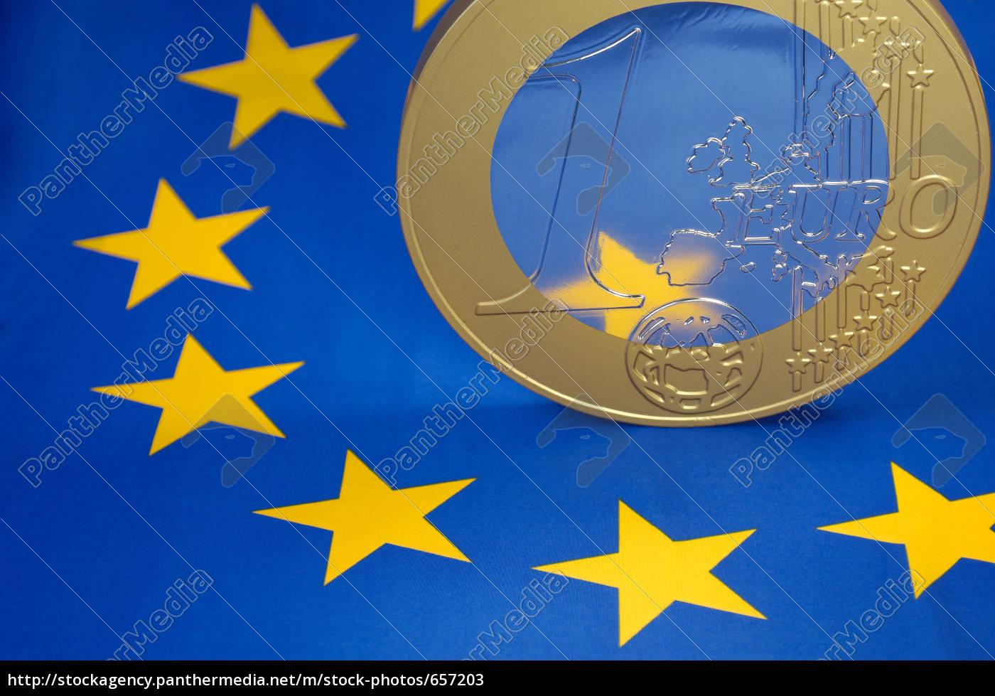 euro, coin, on, the, european, flag - 657203