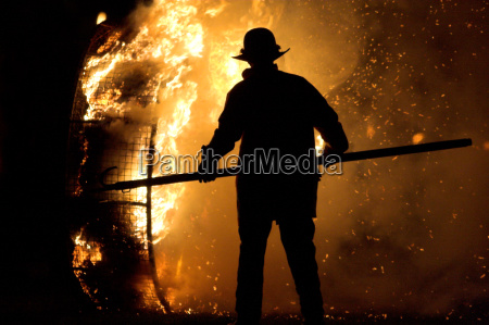 fireman, at, the, fire, wheel, in - 658475