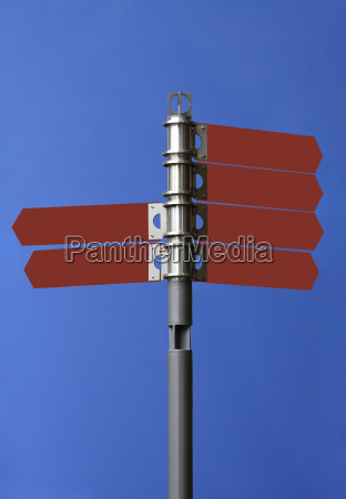 signpost in front of sky