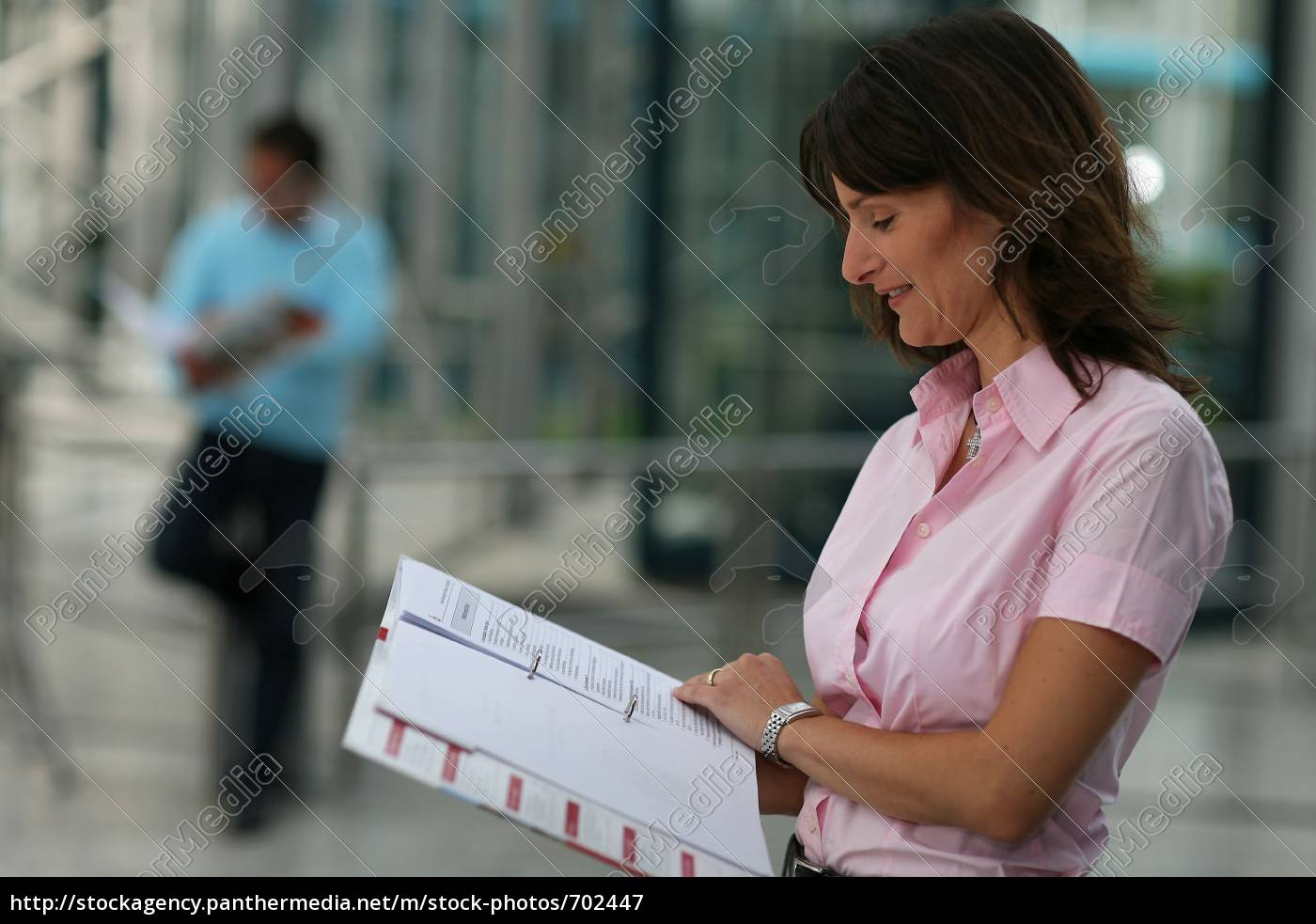 woman, studying, man, in, the, background - 702447