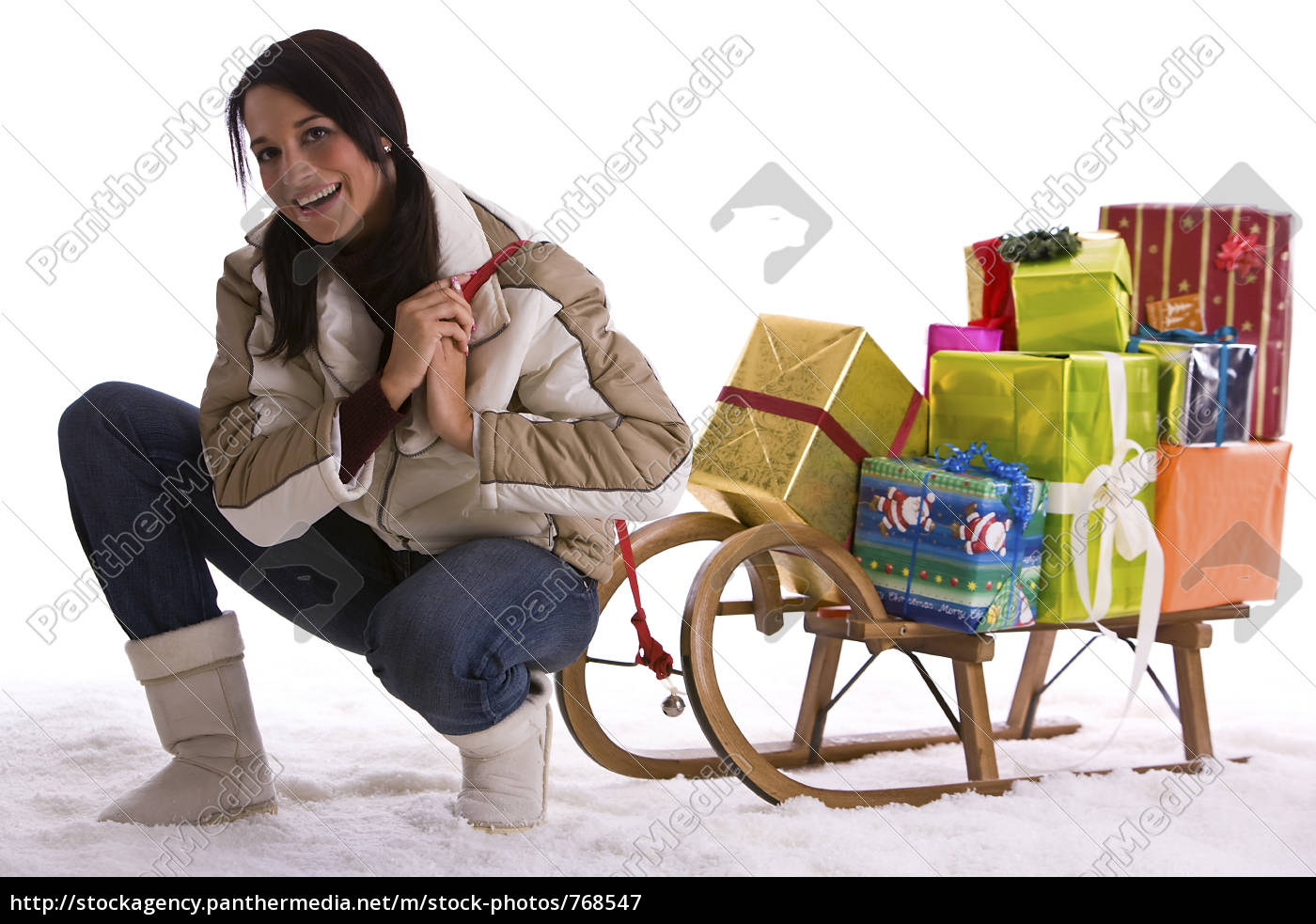 woman, pulling, sledge, with, gifts - 768547