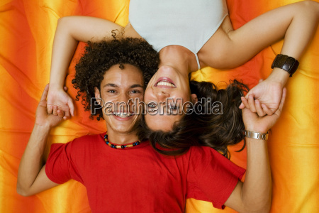 young, couple, playing, on, the, bed - 773353