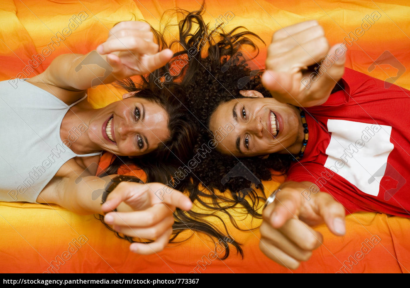 young, couple, playing, on, the, bed - 773367