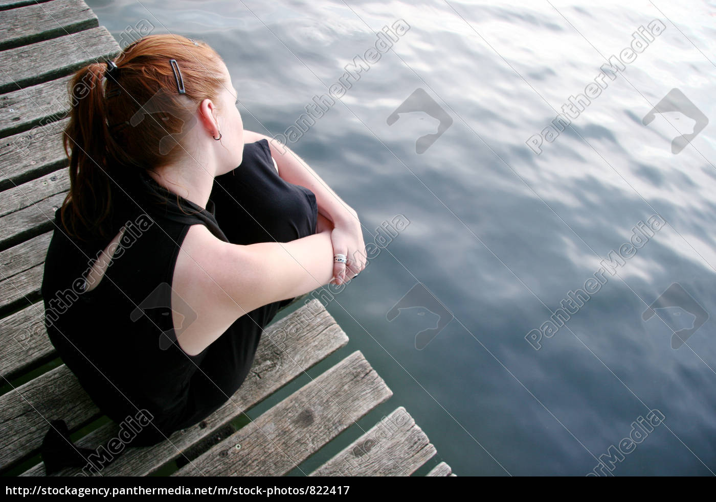 thoughtful, young, woman, at, the, footbridge - 822417