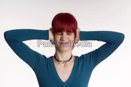 woman holding ear