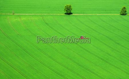 red machin in green field