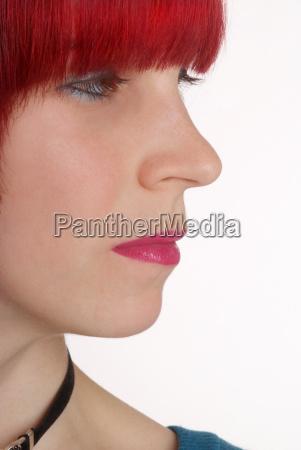 woman face closed dramatic listless redheaded