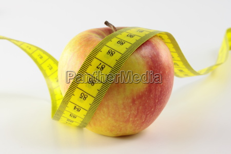 an apple and a measuring tape