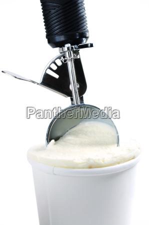 tub of vanilla ice cream with
