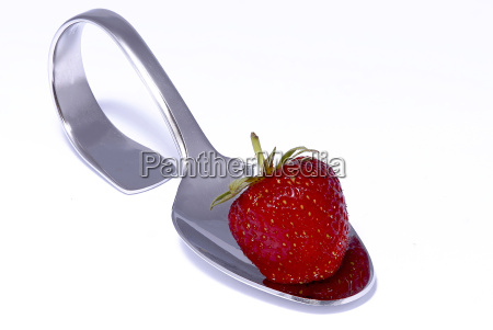 strawberry on spoon