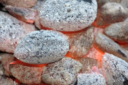 glowing charcoal in a grill
