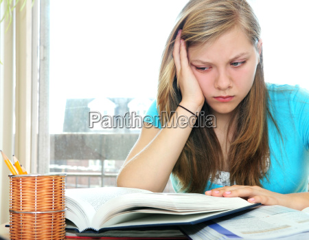 teenage, girl, studying, with, textbooks - 1321773