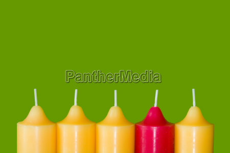 six candles against green background
