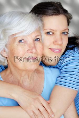 hugging grandmother and granddaughter adult