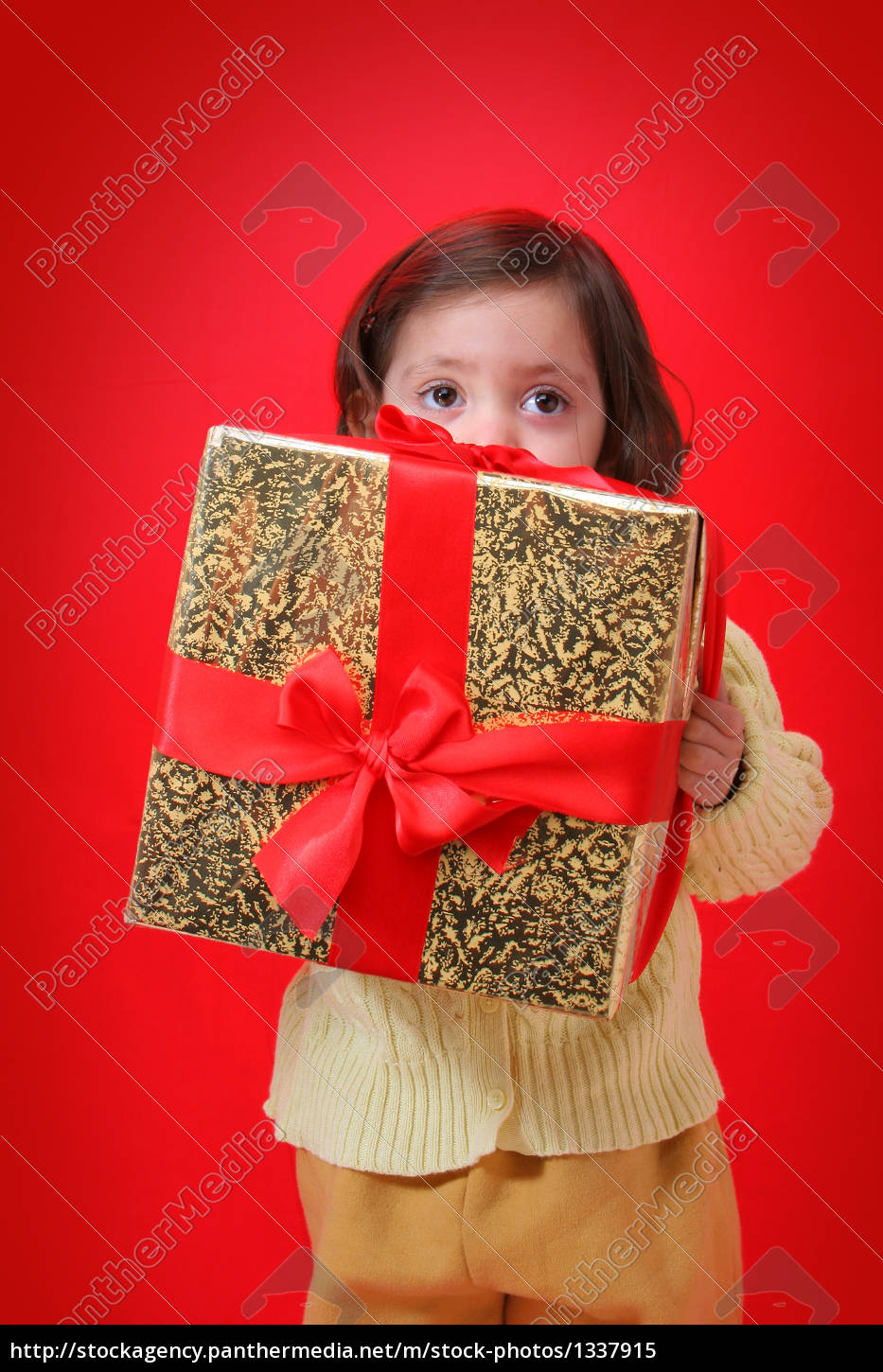 toddler, with, a, christmas, gift - 1337915