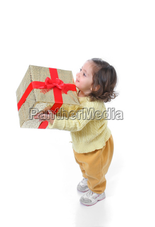 toddler, with, a, christmas, gift - 1337923