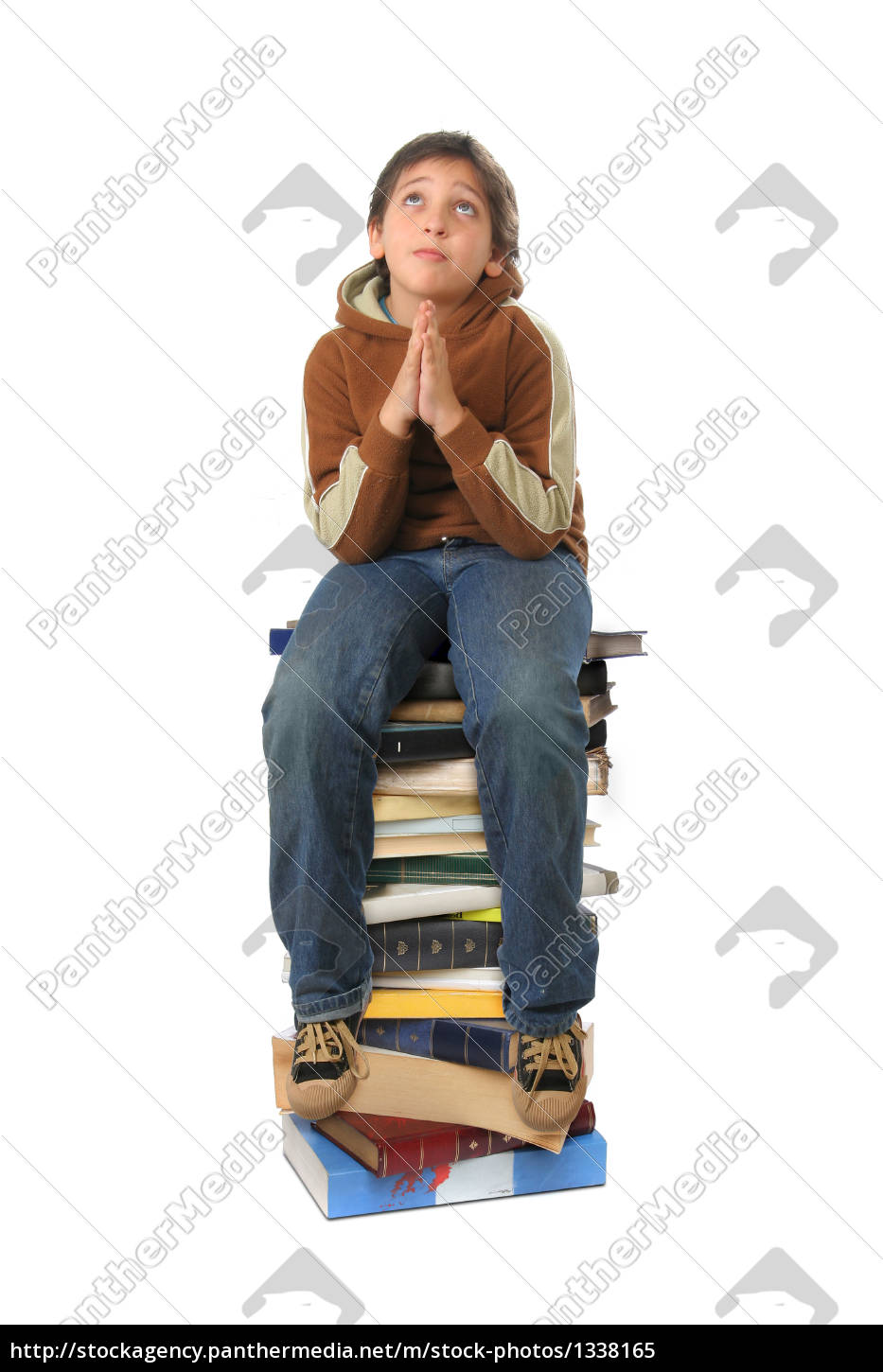 student, sitting, on, a, pile, of - 1338165