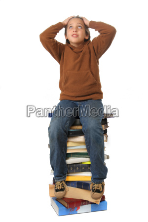 student, sitting, on, a, pile, of - 1338169