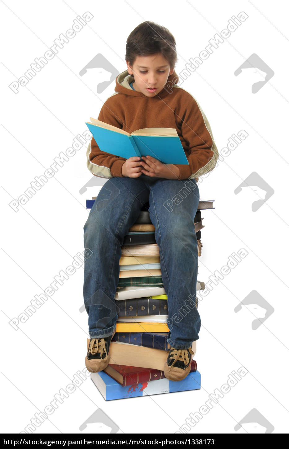 student, sitting, on, a, pile, of - 1338173