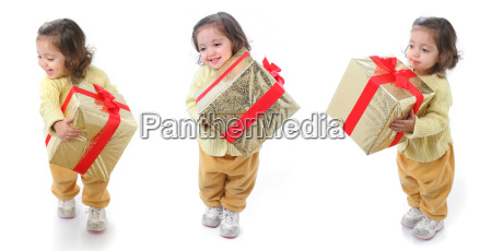 toddler, with, a, christmas, gift - 1338015