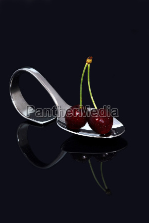 pair of cherries on the spoon