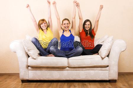 three women when cheering on a