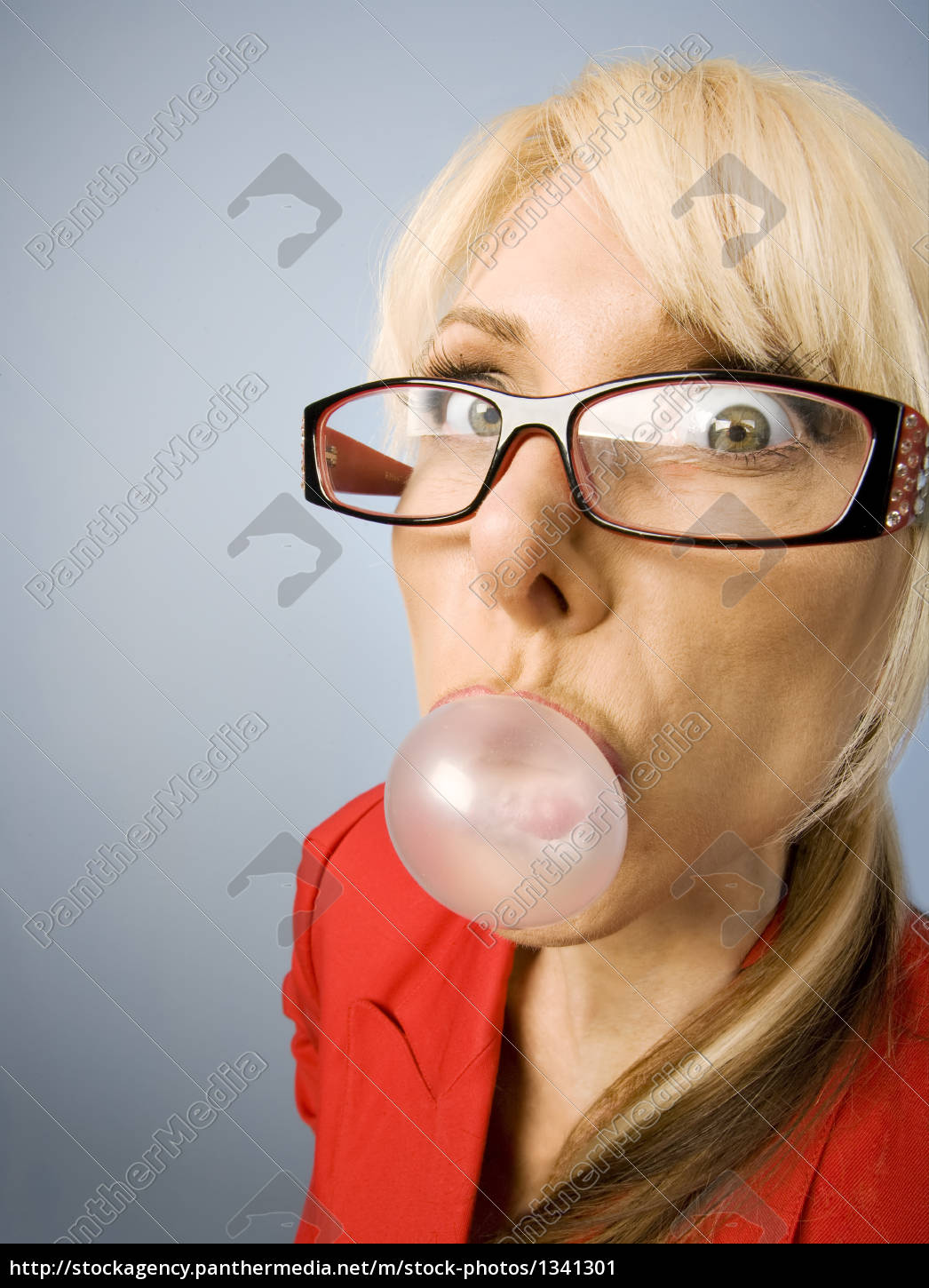 woman, in, red, blowing, a, bubble - 1341301