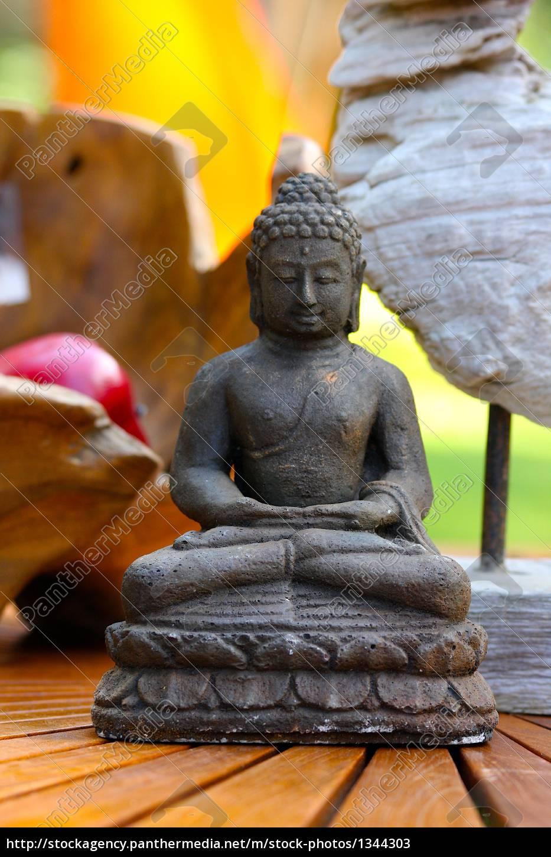 meditating, buddha, on, wooden, table - 1344303