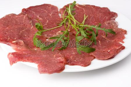 beef carpaccio with rocket salad