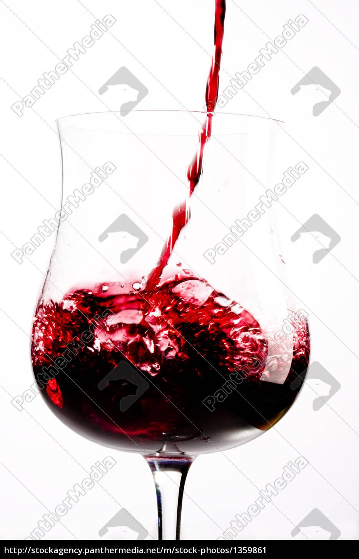 red, wine, splashing, in, a, glass - 1359861