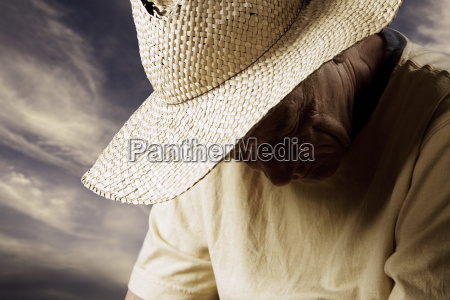 sad, man, in, a, straw, hat - 1359863