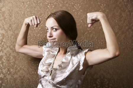 young, woman, flexing, her, biceps - 1365083