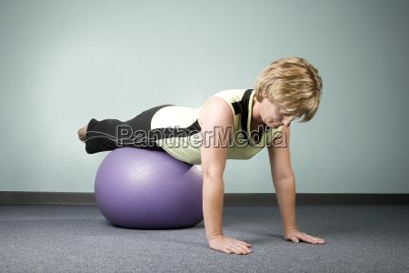 woman, balancing, on, an, exercise, ball - 1372205