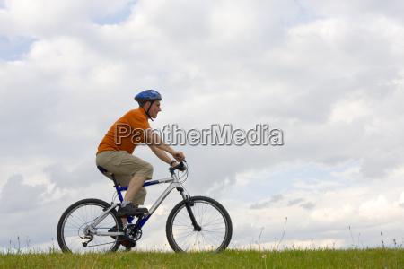 man, is, riding, a, mountain, bike - 1374897