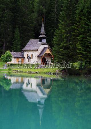 church chapel mirroring mountain lake fresh