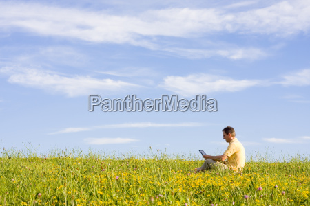man, with, laptop, on, meadow - 1437729