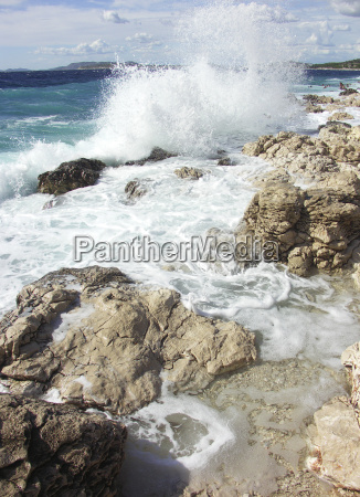 impact, of, large, waves, against, rocks - 1445381