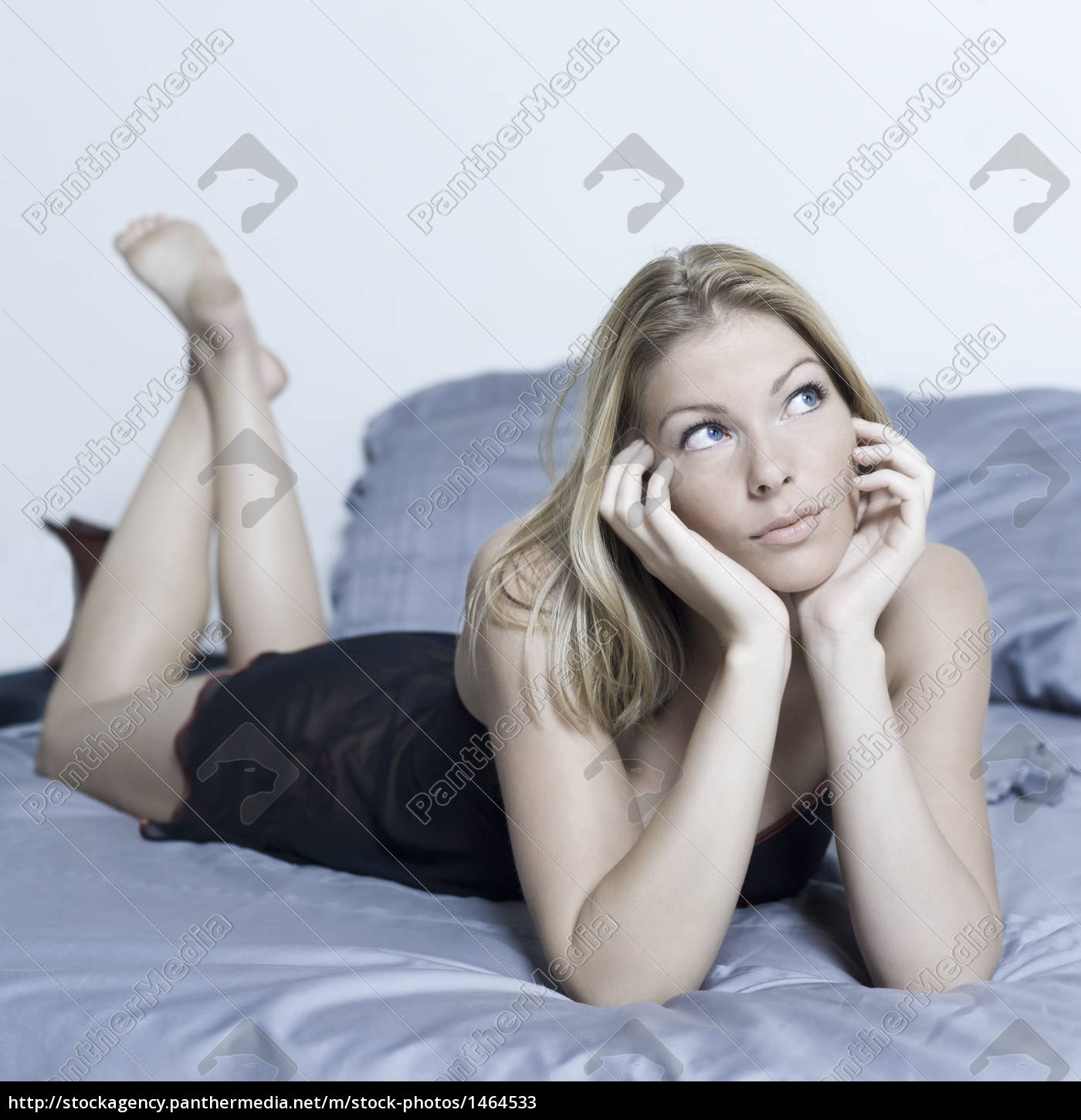 woman, lying, on, a, bed - 1464533