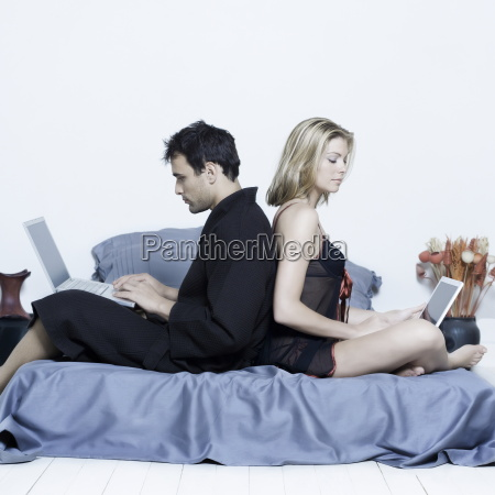 young, couple, in, a, bed - 1464583