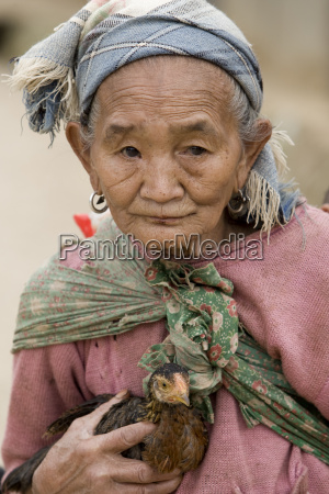asia old woman with chicken