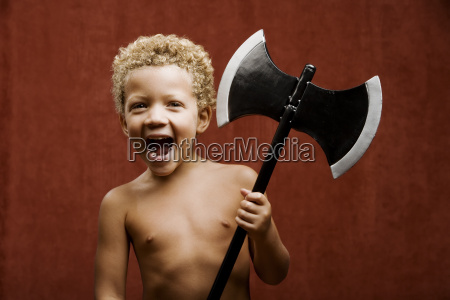 young boy with a toy hatchet