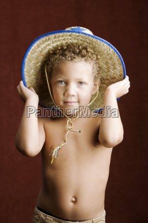 little boy in a sheriff hat