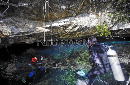 scuba divers in cenote