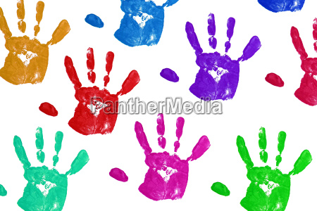 close up colorful child handprints on
