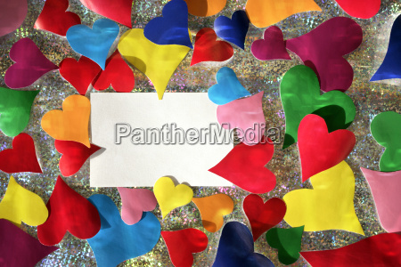 colorful paper hearts and note